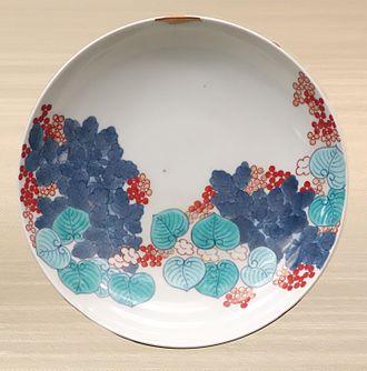 Kintsugi - Small repair (top) on Nabeshima ware dish with hollyhock design, overglaze enamel, 18th century, Edo period (Tokyo National Museum)