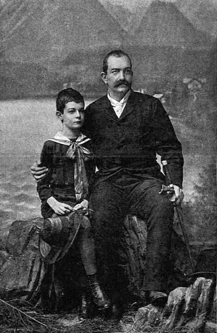 Young Alexander with his father King Milan in 1888 less than a year before Milan abdicated the throne in favour of his underage son. Divlad Milan szerb kiraly 1888-32.jpg