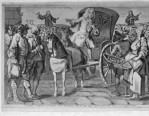 Kennington Common - An engraving of Doctor Rock, an itinerant vendor of medicines, selling his wares from a horse-drawn carriage to a crowd at Kennington common while John and Charles Wesley preach in the background c. 1743.