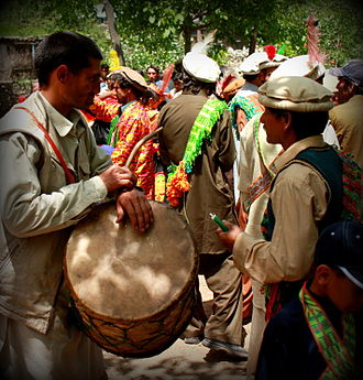 Kalash people - A drummer during the Joshi festival in Bumberet, Pakistan. Drumming is a male occupation among the Kalash people.