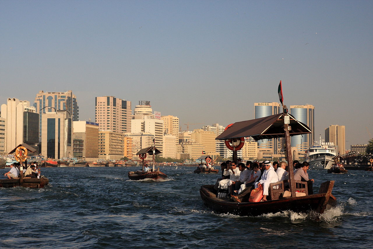 tourist-filled boats in choppy water