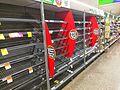 Empty bread shelf at supermarket.jpg