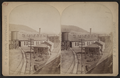 Erie Railroad yard showing round house, watertower and switching yard, by W. L. Sutton 2.png