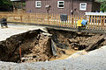 FEMA - 41432 - A sink hole next to a home in Perry County Kentucky.jpg