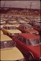 FIELDS POINT ON THE WATER-FRONT. NEW CARS IN FOREGROUND AND SCRAP METAL FROM SHREDDED CARS IN THE BACKGROUND-READY... - NARA - 547469.tif