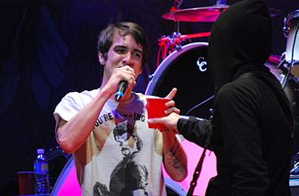 "Folie à Deux (album) - Fall Out Boy performing with Panic! at the Disco's Brendon Urie, who provided vocals for the songs ""20 Dollar Nose Bleed"" and ""What a Catch, Donnie""."