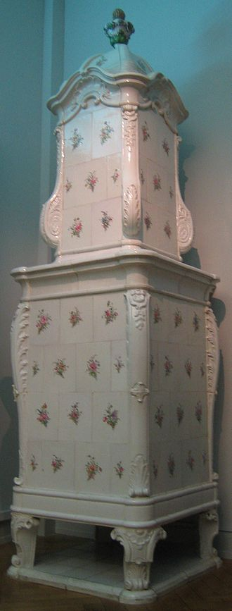 Frisching Faience Manufactory - Faience stove produced by the Frisching Faience Manufactory. This faience stove was part of the interior of The White House (Wendelstörferhof) of the Sarasin family of Basel. Today this faience stove is exhibited in the Historical Museum of Bern
