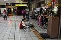 Female Seller of 7-Eleven No.1 Taipei Store Stacking Newpapers on Cart in Morning 20151121.jpg