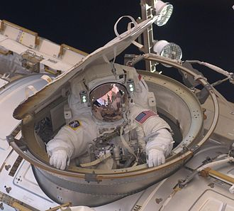Andrew J. Feustel - Feustel re-entering the International Space Station after the second spacewalk of the STS-134 mission.