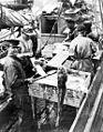 Fishermen dressing codfish aboard the power schooner UNION JACK, Alaska, May 1913 (COBB 209).jpeg