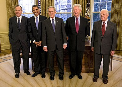 From left to right: George H. W. Bush, Barack Obama, George W. Bush, Bill Clinton, and Jimmy Carter. Five Presidents Oval Office.jpg