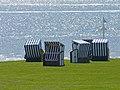 Five roofed wicker beach chairs.jpg