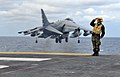 Flickr - Official U.S. Navy Imagery - A Sailor renders a salute to an AV-8B Harrier from Marine Attack Squadron..jpg