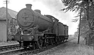 LNER Class J38 - Gresley J38 0-6-0 No. 65925 and brake van on a goods working at the site of Forest Mill station,