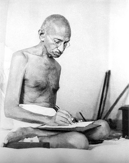 Gandhi in 1942, the year he launched the Quit India Movement Gandhi writing 1942.jpg