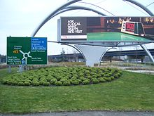 Grassy median, with billboard and road sign