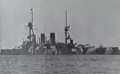 Georgios Averof in dazzle paint, Bombay Harbor, 1942.png