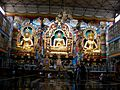 Golden statues of Gautama Buddha, Padmasambhava and Amitāyus at Bylakuppe.jpg