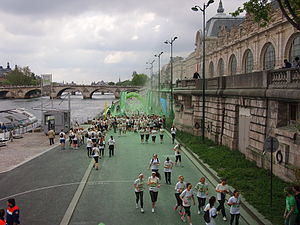 The Color Run - Participants in the 2014 Color Run in Paris passing the green station, located next to the Musée d'Orsay