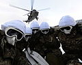 Groundcrew Sheltering from Helicopter Downwash in Norway MOD 45155036.jpg