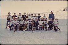 HOCKEY TEAM PICTURE IS TAKEN AT THE WEST SIDE PARK IN NEW ULM, MINNESOTA. PHYSICAL FITNESS IS STRESSED IN THIS... - NARA - 558202.jpg