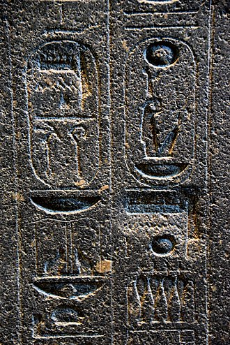 Amenhotep III - Hieroglyphs on the backpillar of Amenhotep III's statue. There are 2 places where Akhenaten's agents erased the name Amun, later restored on a deeper surface. The British Museum, London