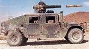 a TOW missile leaves the tube of a HMMWV-mounted launcher