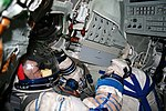 In the Soyuz simulator with the Sokol suit on. (6376244937).jpg