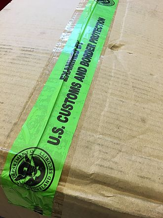 U.S. Customs and Border Protection - Tape used by U.S. Customs and Border Protection to reseal packages that they have searched, and to indicate that they have done so