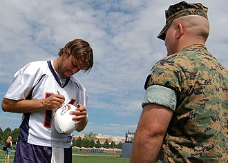 Jake Plummer - Plummer signs a football at Broncos training camp in 2006.