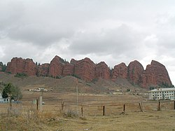 A view of Jeti-Ögüz rock formation that includes one of the buildings of the health resort (right)