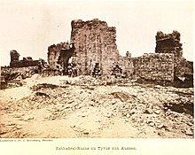 An old photograph of the ruins of a large stone building