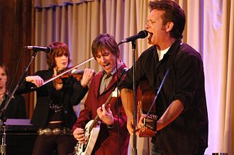 John Mellencamp - Mellencamp (right) and his band perform at Walter Reed Army Medical Center in 2007.