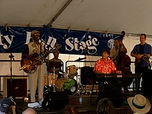 Bassett and his band performing at the Great Lakes Folk Festival, 2006