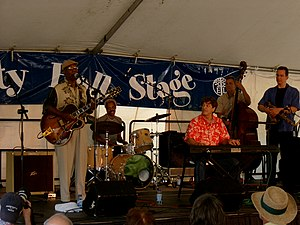 Johnnie Bassett - Bassett and his band performing at the Great Lakes Folk Festival, 2006