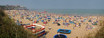 Beach crowd along Joss Bay seashore, in Broadstairs during July.