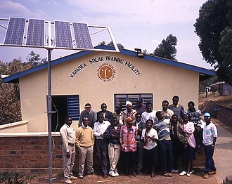 Gaspar Makale - Solar training course at the KARADEA Solar Training Facility (KSTF), 1996, Gaspar Makale (front row, first on right), Daniel Kithokoi (back row, first on right) Mark Hankins (back row, first on left) (click for higher resolution)