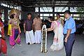 Kairali Suresh, President Naval Wives Welfare Association (NWWA) inaugurating Onam festival at Indian Naval Academy by lighting 'bhadradeepam' the traditional oil lamp.jpg