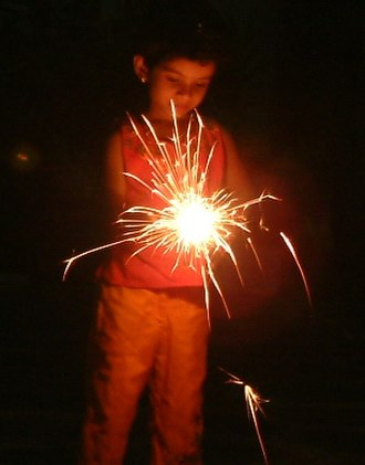 Vishu - A child playing with fireworks on Vishu