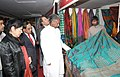Kavuru Sambasiva Rao visiting the stall after inaugurating the Silk Mark Expo 2014, in New Delhi on January 15, 2014. The Secretary, Ministry of Textiles, Ms. Zohra Chatterji is also seen.jpg