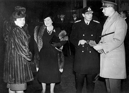 The Duke and Duchess of Gloucester are seen off on their departure for Australia by the King and Queen, 1945 King George VI and Queen Elizabeth with the Gloucesters.jpg
