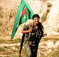 Kurdish YPG Fighter (19833276809).jpg