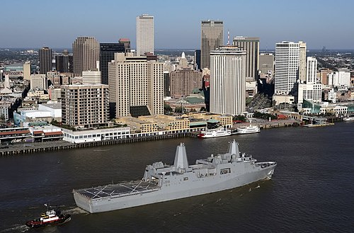 A view of the New Orleans Central Business District as seen from the Mississippi River. USS New Orleans (LPD-18) in foreground (2007) LPD18USSNewOrleansPassingNewOrleans.jpg