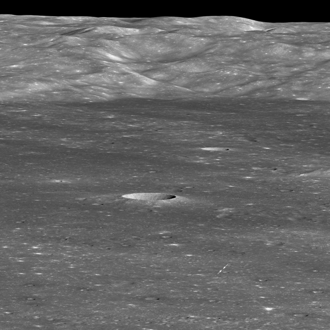View of landing site, marked by two small arrows, taken by the Lunar Reconnaissance Orbiter on 30 January 2019 LRO Chang'e 4, first look.png
