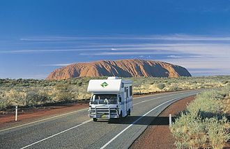 Tourism in Australia - Driving on the Lasseter Highway near the Uluru-Kata Tjuta National Park in the Northern Territory.