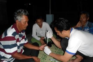 Blood samples being taken from several men