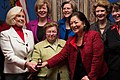 Lilly Ledbetter with senators.jpg