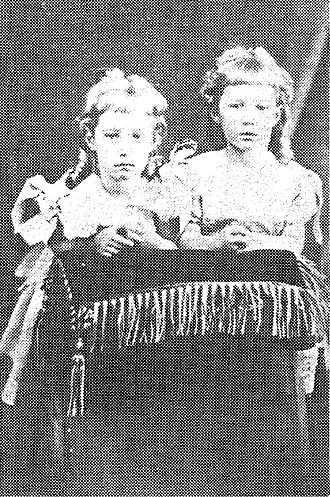 Lily Poulett-Harris - Lily Poulett-Harris (left) and her twin sister, Violet, as children.