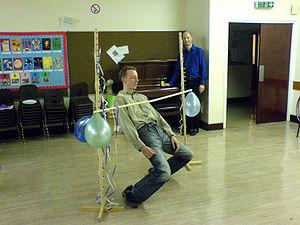 Limbo (dance) - Limbo dancer attempting lowered pole.