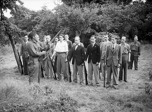 Local Defence Volunteer (LDV) recruits learning rifle drill at Buckhurst Hill, Essex, 1 July 1940. H2007